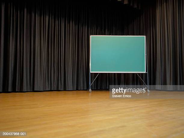Blank chalkboard on school stage