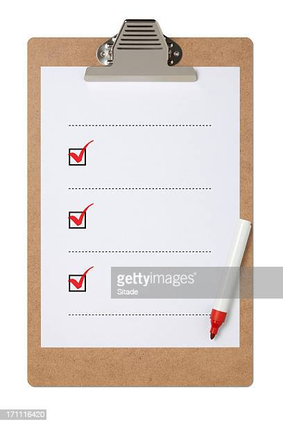 Blank checklist on clipboard with three red check marks