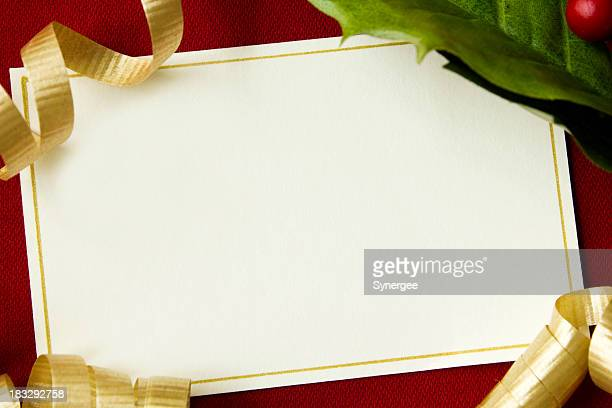 A blank Christmas card on a red background