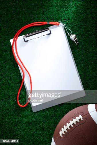 Blank Clipboard on AstroTurf with a Football