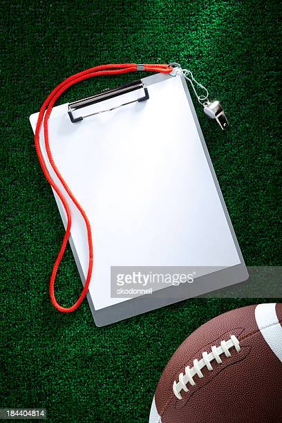 Blank Clipboard on AstroTurf with a Football
