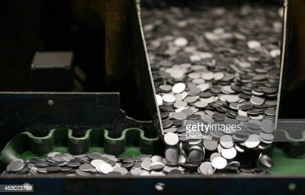 Blank coins that have been produced at the Royal Mint are sorted before being sent to be stamped in the coin press on August 1 2014 in Llantrisant...