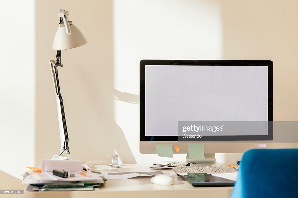 Blank computer monitor on desk