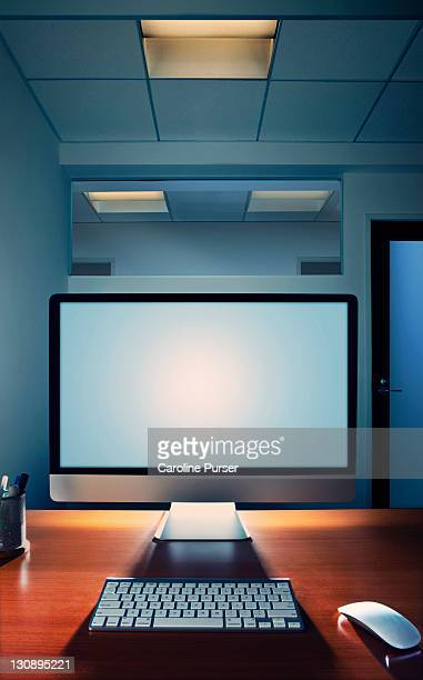 Blank computer screen on a desk in an office