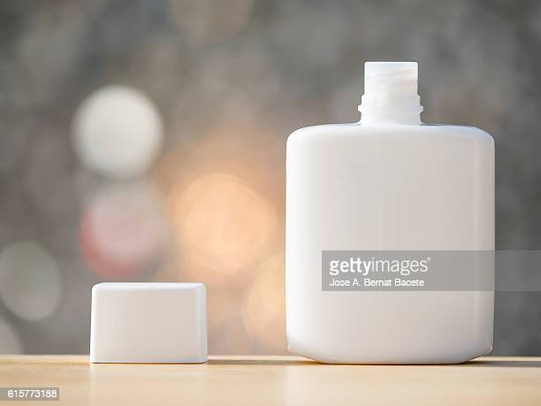 Blank cosmetics containers, close up, aftershave,  illuminated by sunlight