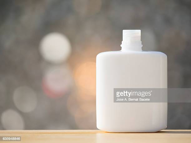 Blank cosmetics containers, close up, aftershave lotion , illuminated by sunlight