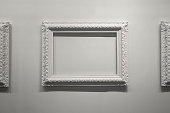 Blank empty picture frames on the wall