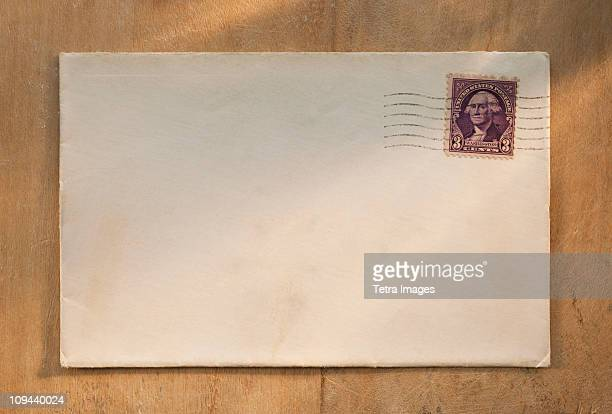 Blank envelope on wooden table