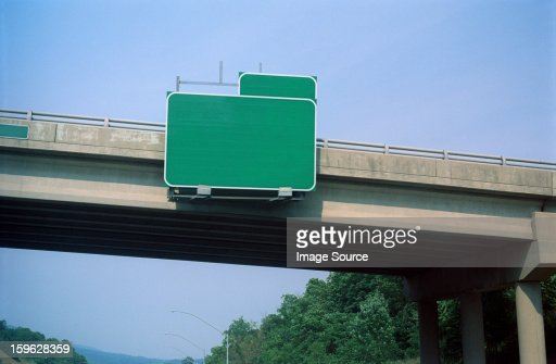 Blank exit sign on highway overpass