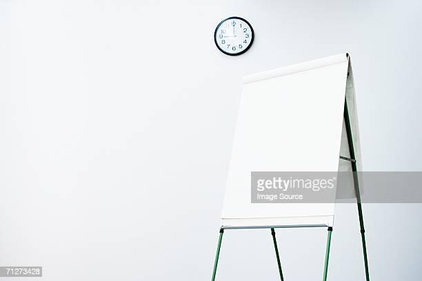 Blank flipchart in office