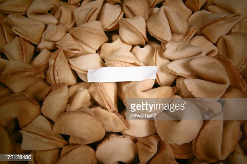 Blank fortune in a sea of fortune cookies