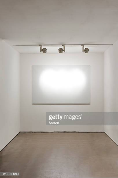 Blank frame on the wall at art gallery