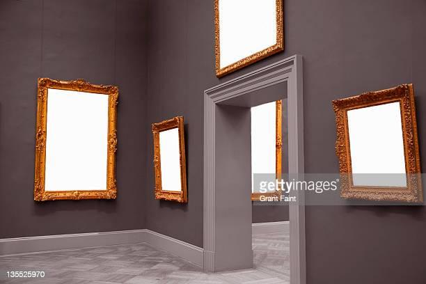 Blank framed paintings in museum.