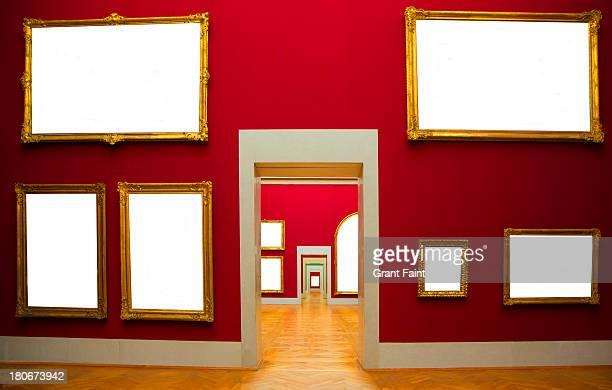 Blank frames hanging in gallery.