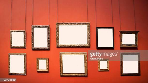 10 blank frames on wall