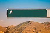 Blank Freeway Exit Sign With Arrow