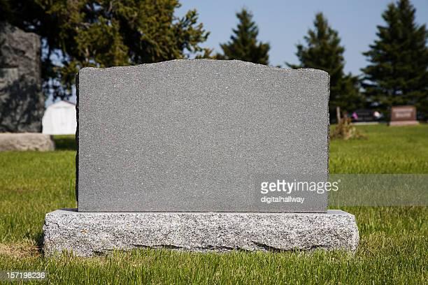 Blank gravestone in grassy graveyard
