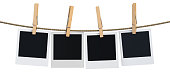 Blank instant photo hanging on the clothesline, 3D rendering isolated on white background