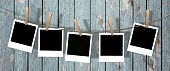 blank instant photos hanging on the clothesline