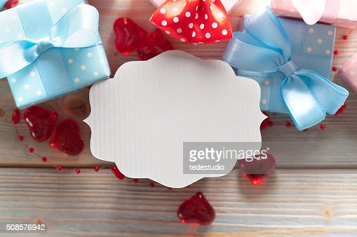Blank label and gift boxes on wooden background : Stockfoto