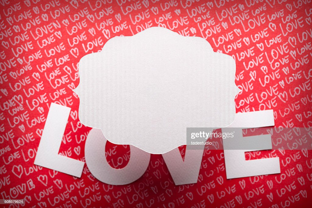 Blank label and love inscription on paper background : Bildbanksbilder