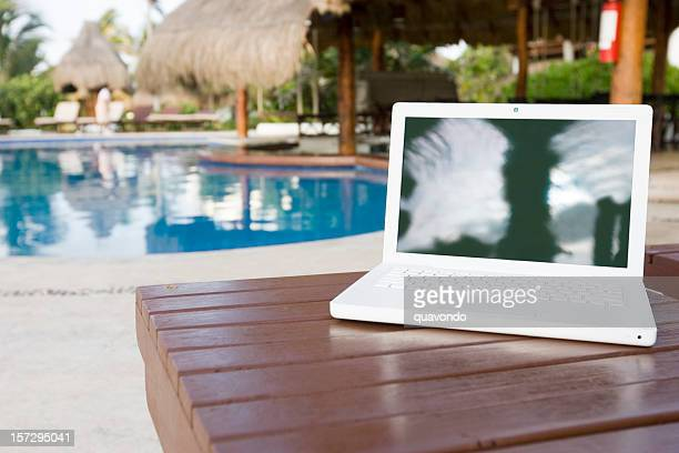 Blank Laptop at Empty Tropical Swimming Pool, Copy Space