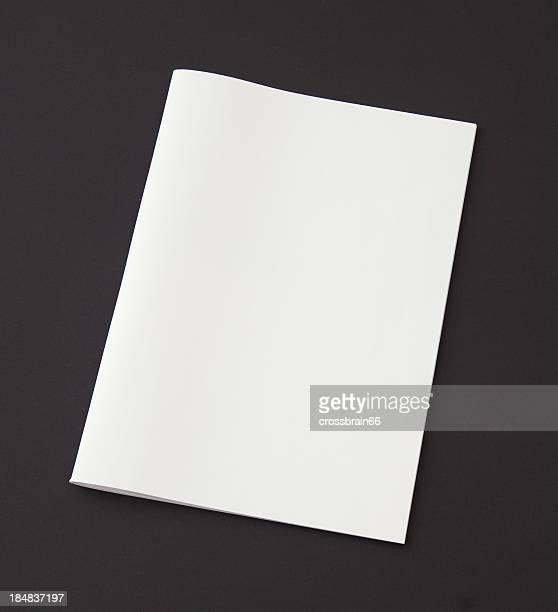 blank magazine on black background