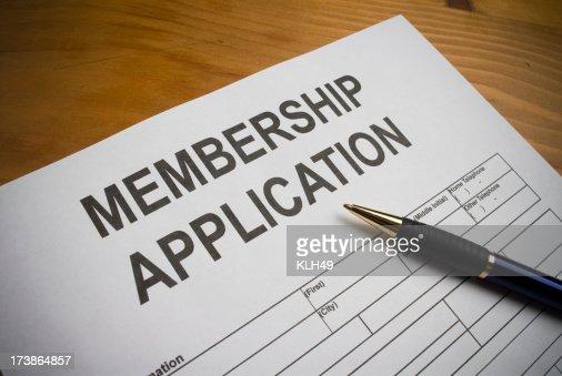 Blank membership application on desk with ballpoint pen
