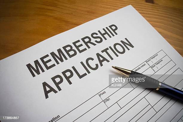 Blank membership application on desk with ballpoint pen
