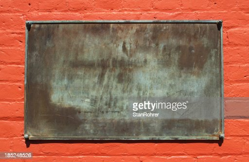 Blank Metal Sign On Painted Red Brick