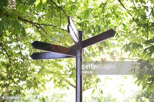 Blank metal signpost on green background : Stock Photo