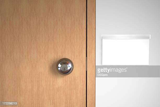 A blank name logo and a stainless door handle on wooden door