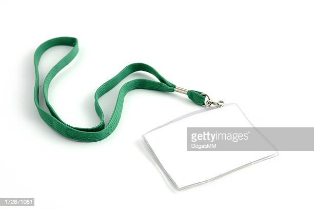 Blank name tag with a green lanyard isolated on white