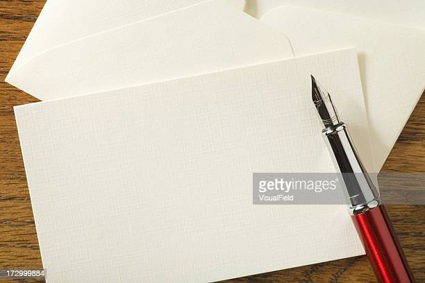 Blank Note Card with Pen on Desk