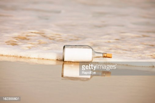 Blank note in washed-up bottle: you add the message