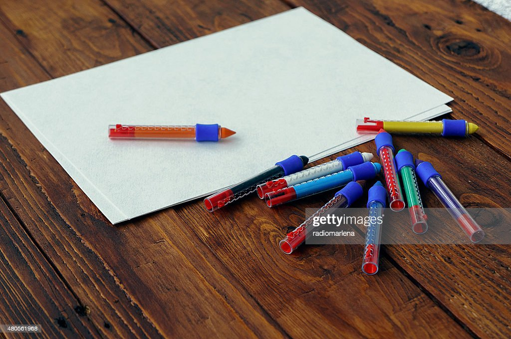 Blank paper and colorful pencils on the wooden table. : Stock Photo