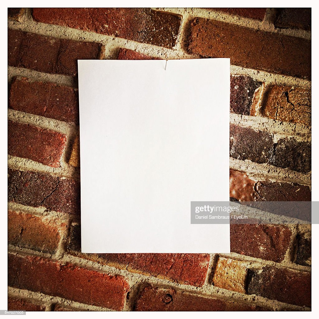 Blank Paper Hanging On Brick Wall