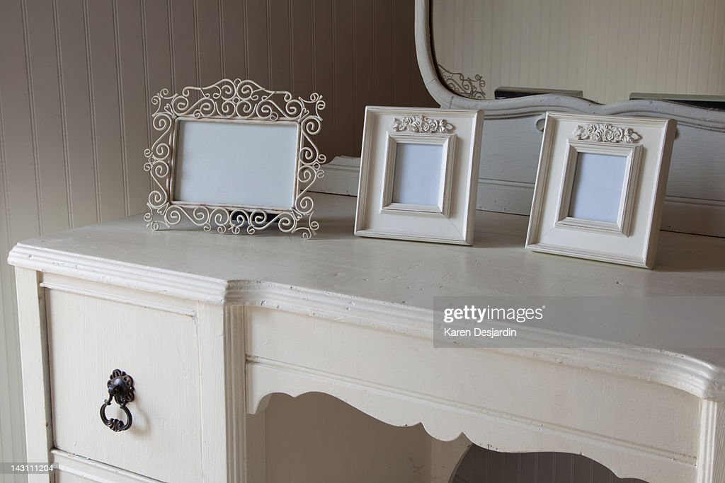 Blank picture frames on dressing table : Stock Photo