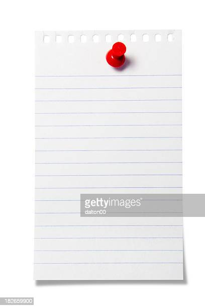Blank piece of note paper stuck to the wall with a push pin