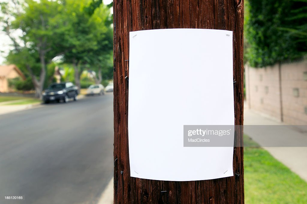 Blank piece of paper hanging on the telephone pole