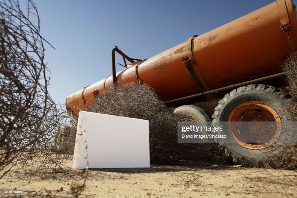 Blank placard next to abandoned tanker truck : Stock Photo