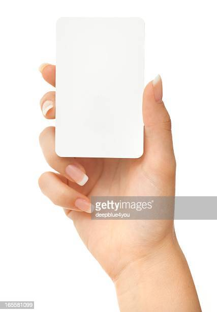 Blank play card in woman hand on white