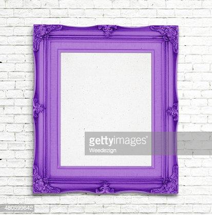Blank purple Vintage photo frame on white brick wall : Stock Photo
