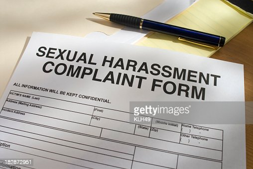 Blank Sexual Harassment Complaint Form and pen