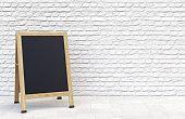 Wooden street sidewalk sign with blank menu chalk blackboard over white brick wall. 3D illustration