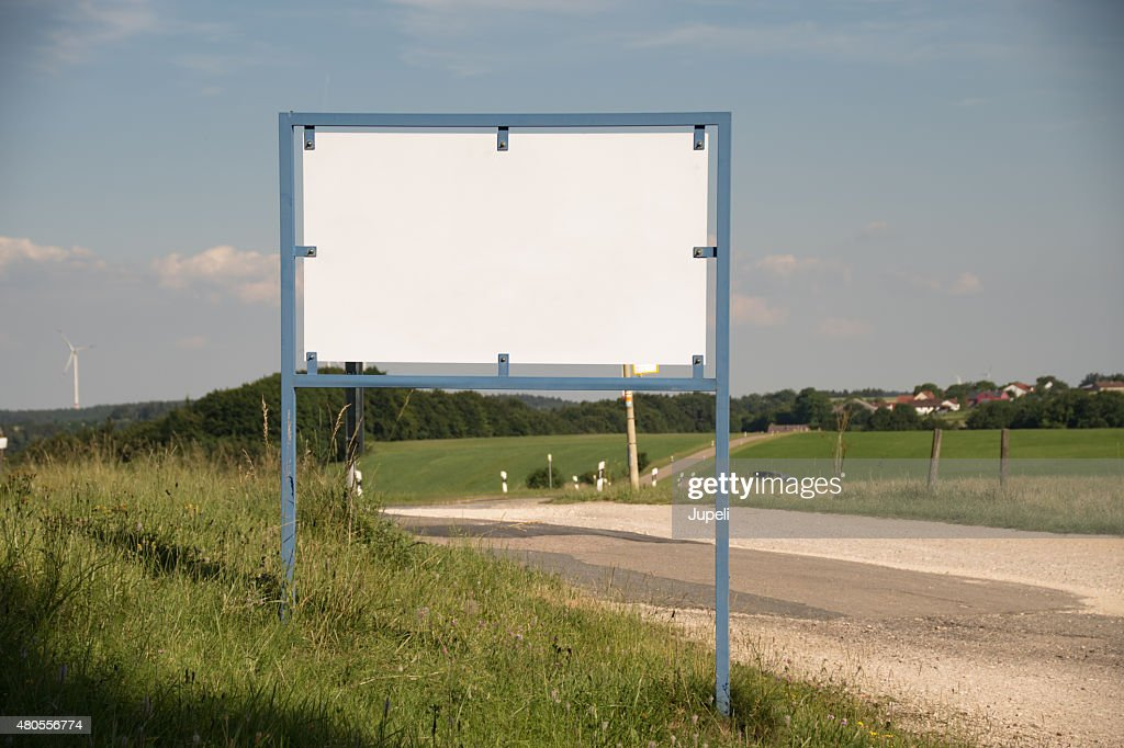 Blank sign in smiling landscape : Stock Photo