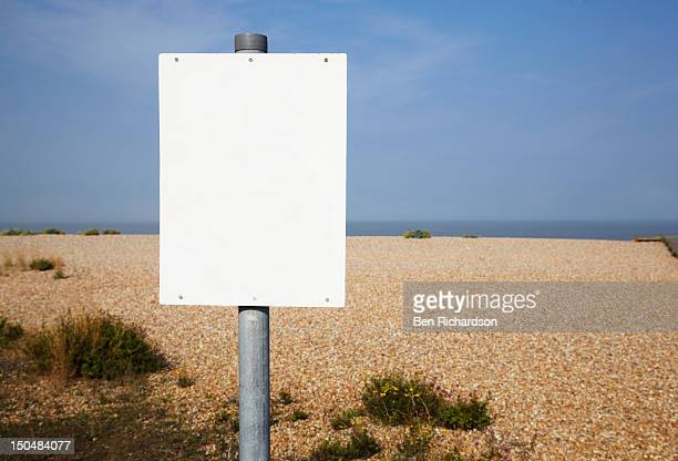 A blank sign on the beach