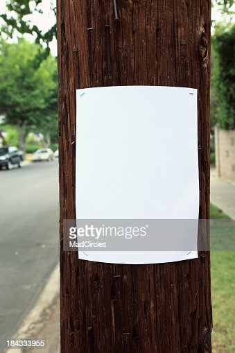 Blank sign stapled to a telephone pole.