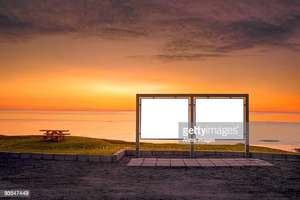 Blank signs at sunset