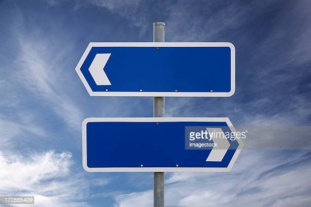 Blank signs on cloudy sky